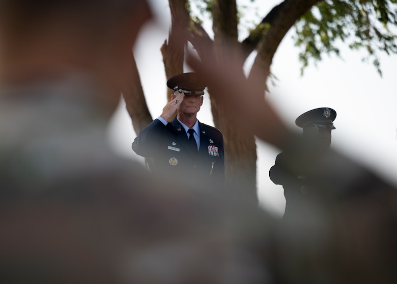 U.S. Air Force Col. David S. Miller, 377th Air Base Wing outgoing commander, renders a salute.