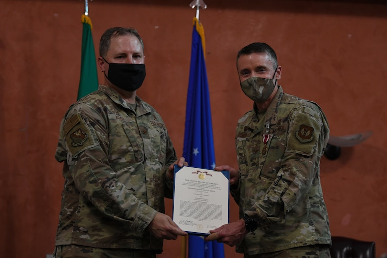 U.S. Air Force Col. Wade Adair, 31st Medical Group commander, left, and U.S. Air Force Col. Mark Roberts, 31st Dental Squadron (DS) outgoing commander, pose for a photo during a change of command at Aviano Air Base, Italy, June 22, 2021. The 31st DS integrates community-based preventive dental services and utilizes all dental resources to enable peak mission readiness and sustained performance. (U.S. Air Force photo by Airman First Class Taryn Onyon)