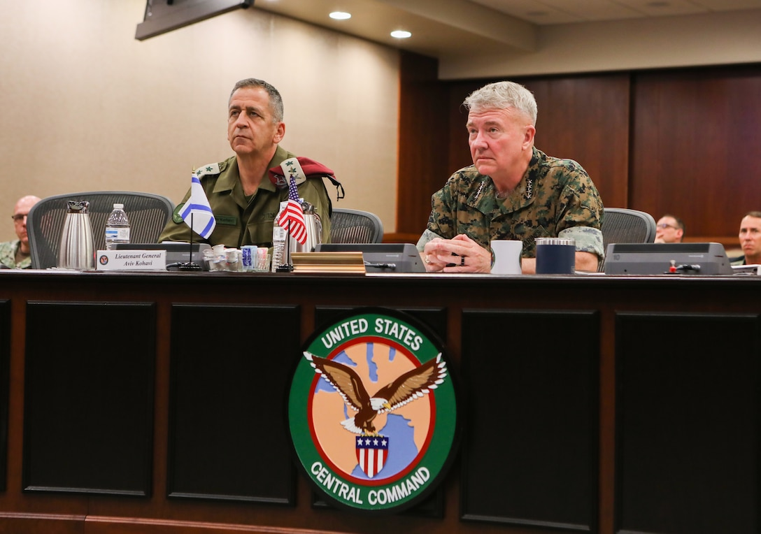 U.S. Marine Corps Gen. Kenneth F. McKenzie, commander of U.S. Central Command (CENTCOM), right, and Lt. Gen. Aviv Kohavi, Israel Defense Forces Chief of General Staff, left, attend a briefing at U.S. Central Command headquarters, June 22, 2021. During Kohavi's visit the leaders discussed a range of issues, such as the situation in the West Bank, Jerusalem and Gaza, the current security challenges emanating from the Middle East and the ongoing effort to realign Israel from U.S. European Command to CENTCOM. McKenzie and Kohavi agreed that the realignment will help broaden the bilateral and multilateral relationships that already exist between Israel, Gulf nations and the United States. (U.S. Central Command Public Affairs photo by Tom Gagnier)