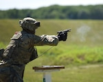 A Soldier with the 1776th Military Police Company, Michigan Army National Guard, conducts M9 pistol qualification during annual training at Fort Custer Training Center, Augusta, Michigan, June 16, 2021.