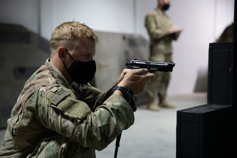Sgt. Chad Phillips, an infantryman with Company B., 2nd Combined Arms Battalion, 136th Infantry Regiment, engages his targets during a weapons event for the U.S. Army Central 2021 Best Warrior Competition at Camp Arifjan, Kuwait, June 22, 2021. The competitors conducted various weapons qualification using the Engagement Skills Trainer II as part of the event.(U.S. Army photo by Staff Sgt. True Thao, U.S. Army Central Public Affairs)