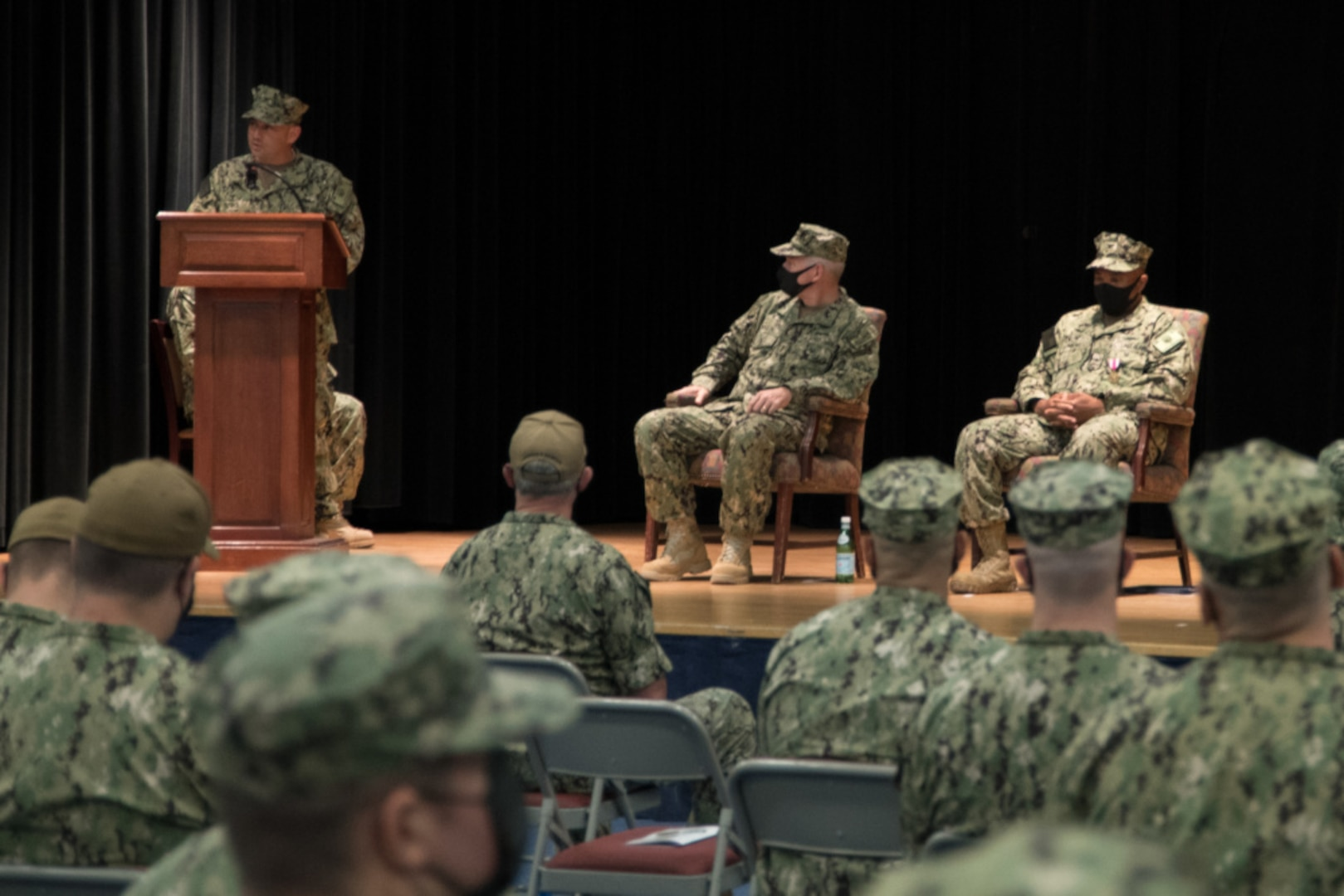 NAVAL SUPPORT ACTIVITY BAHRAIN (June 16, 2021) Capt. Benjamin Berg, incoming commander of Patrol Forces Southwest Asia (PATFORSWA) gives remarks during a change of command ceremony onboard Naval Support Activity Bahrain, June 16. PATFORSWA is the Coast Guard's largest unit outside of the U.S. playing a key role in supporting Navy security cooperation, maritime security, and maritime infrastructure protection operations in the U.S. 5th Fleet area of operations. (U.S. Navy photo by Mass Communication Specialist 2nd Class Matthew Riggs)
