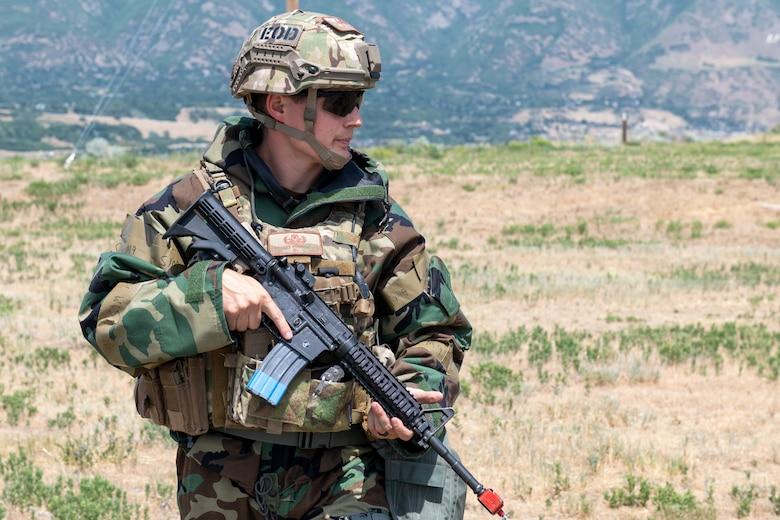 An Airman stands bearing a rifle.