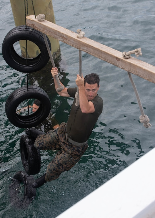 U.S. Marine Corps Capt. Mitchell Moore, a native of Carmel, Ind., platoon commander with 2d Reconnaissance Battalion (2d Recon), 2d Marine Division, participates in a water obstacle during Exercise Caribbean Coastal Warrior on Savaneta Kamp, Aruba, June 18, 2021. The exercise allows 2d Recon to expand its knowledge and proficiency when operating in littoral and coastal regions while increasing global interoperability with 32nd Raiding Squadron, Netherlands Marine Corps. (U.S. Marine Corps Lance Cpl. Jennifer E. Reyes)