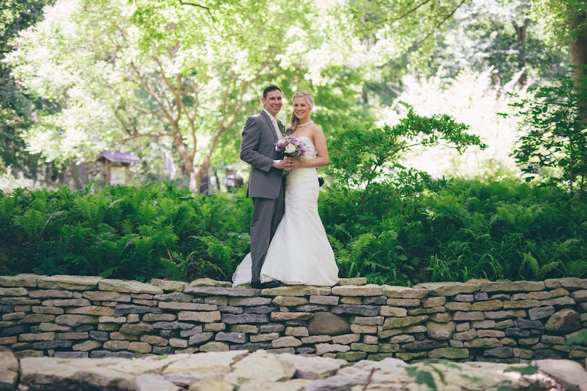 U.S. Air Force Capt. Brian Campbell and his wife Kat Campbell, pose for photos following their wedding ceremony at a nature center in Ohio, June 14, 2014. The couple's mutual love of nature was incorporated throughout the day. (Courtesy photo)