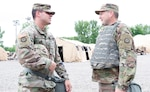 Sgt. Ryan Gartner and Staff Sgt. Brian Foley, both of the 35th Infantry Division, take time to go over their job duties for the day June 9, 2021, during Warfighter 21-05 at Camp Atterbury, Ind.