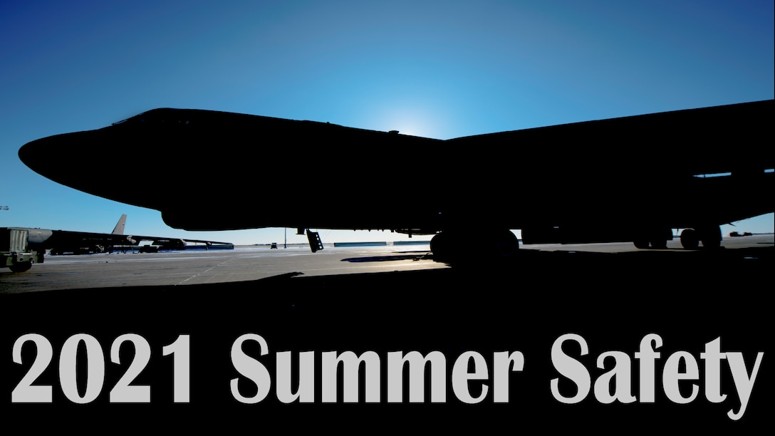 Sun rising behind B52 Stratofortress silhouette. Text 2021 Summer Safety