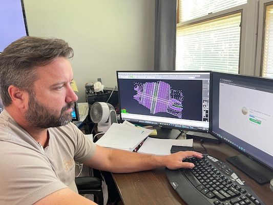 Brian McCain, district surveyor in the Engineering and Construction Division's Survey and Mapping Section, is the U.S. Army Corps of Engineers Nashville District Employee of the Month for April 2021. He is seen here June 23, 2021 in Nashville, Tennessee, working on a computer aided design (CAD) program in support of a project. (USACE Photo)