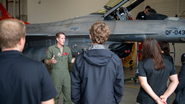 U.S. Air Force Staff Sgt. Eric Huster, 82nd Aerial Targets Squadron E-9A airborne mission systems operator, speaks to students from Junior Leadership Bay about the mission of the 53rd Weapons Evaluation Group during a tour at Tyndall Air Force Base, Florida, June 22, 2021. Tyndall works with different community organizations to provide behind-the-scenes tours showcasing the installation's operational and mission readiness. (U.S. Air Force photo by Brad Sturk)