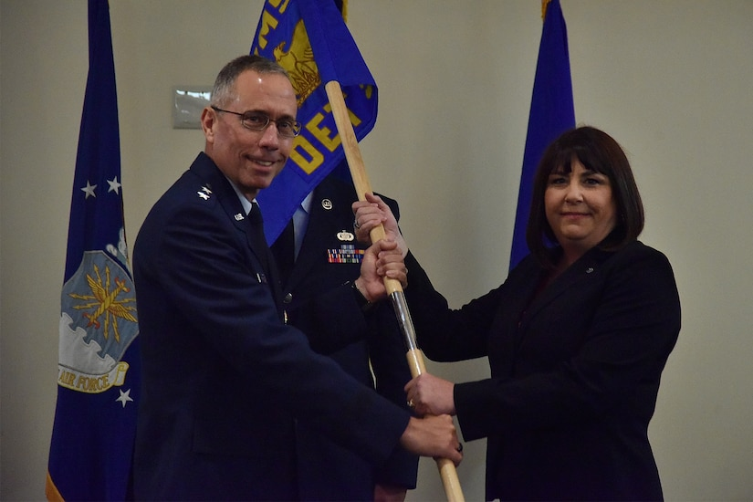 Janeva R. Maxson, right, assumes command of Detachment 5, Air Force Installation and Mission Support Center, by taking the guidon from Maj. Gen. Tom Wilcox, Air Force Installation and Mission Support Center commander, during her assumption of command ceremony, June 17, 2021, at The Club At Andrews, Joint Base Andrews, Md. Maxson is responsible for providing installation and mission support capabilities, to include civil engineering, security forces, and financial services to the Air Force District of Washington and National Capital Region. (U.S. Air Force photo by Senior Airman Daniel Brosam)