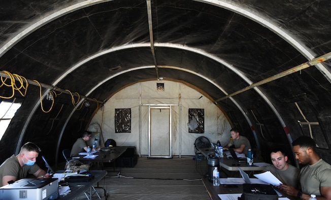 Airmen from the 56th Contracting Squadron participate in a Contingency Contracting Officer exercise June 9, 2021, at Luke Air Force Base, Arizona.