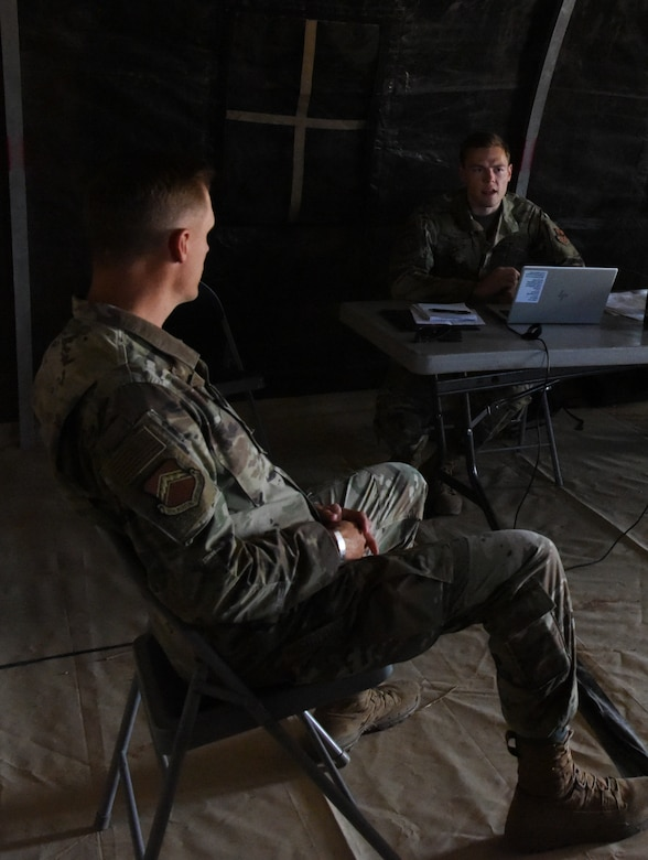 Second Lt. Mitchell Wilcox, right, 56th Contracting Squadron contracting specialist, briefs Col. Ryan Richardson, 56th Mission Support Group commander, during a Contingency Contracting Officer exercise June 9, 2021, at Luke Air Force Base, Arizona.