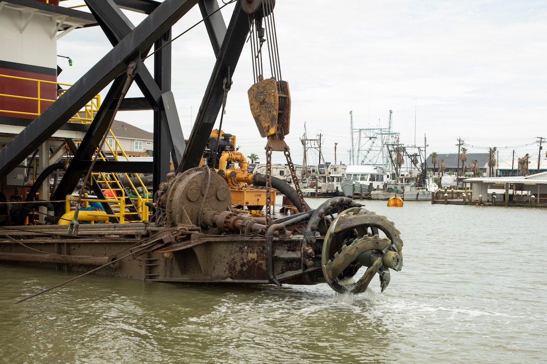 A dredge is a floating barge that basically clears out the bed of a harbor, river, or channel and excavates materials from the bottom of the water. The 'cutter head' of the dredge poses an immediate safety hazard for nearby recreational boaters.