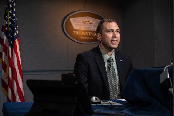 A man participates in a virtual meeting.