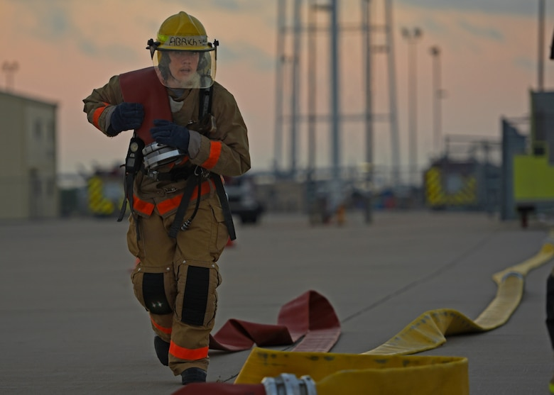 U.S. Air Force Airman Elijah Rich, 312th Training Squadron student, sprints with a fire hose during a training exercise on Goodfellow Air Force Base, Texas, June 11, 2021. The students go through a 68-day course, training and preparing to handle emergencies across the world. (U.S. Air Force photo by Senior Airman Abbey Rieves)