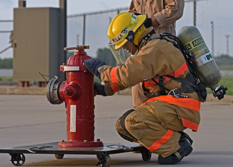 U.S. Navy Petty Officer 3rd Class Anthony Milla, 312th Training Squadron student, operates a fire hydrant during a training on Goodfellow Air Force Base, Texas, June 11, 2021. Milla trained in a joint environment with students from U.S and allied military services. (U.S. Air Force photo by Senior Airman Abbey Rieves)