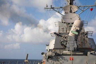 USS Halsey (DDG 97) fires a close-in weapon system.