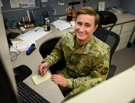 Staff Sgt. Hayden Ullery-Oatney, occupational safety apprentice poses for a photo June 22, 2021, at his desk in the 88th Air Base Wing Safety Office at Wright-Patterson Air Force Base, Ohio. Ullery-Oatney, who came out as at his first Air Force assignment, said he is seeing acceptance and progress for the LGBTQ community serving in the Air Force. (U.S. Air Force photo by R.J. Oriez)