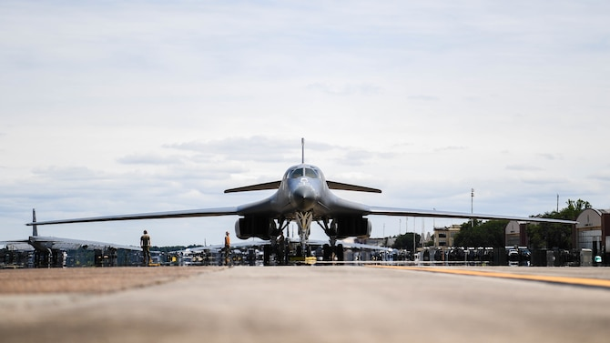 A B-1B Lancer from Dyess Air Force Base, Texas, parks on the flight line at Barksdale Air Force Base, Louisiana, June 22, 2021. The aircraft was flown to Barksdale to become decommissioned and displayed as a part of Barksdale's Global Power Museum airpark of static displays. (U.S. Air Force photo by Senior Airman Jacob B. Wrightsman)