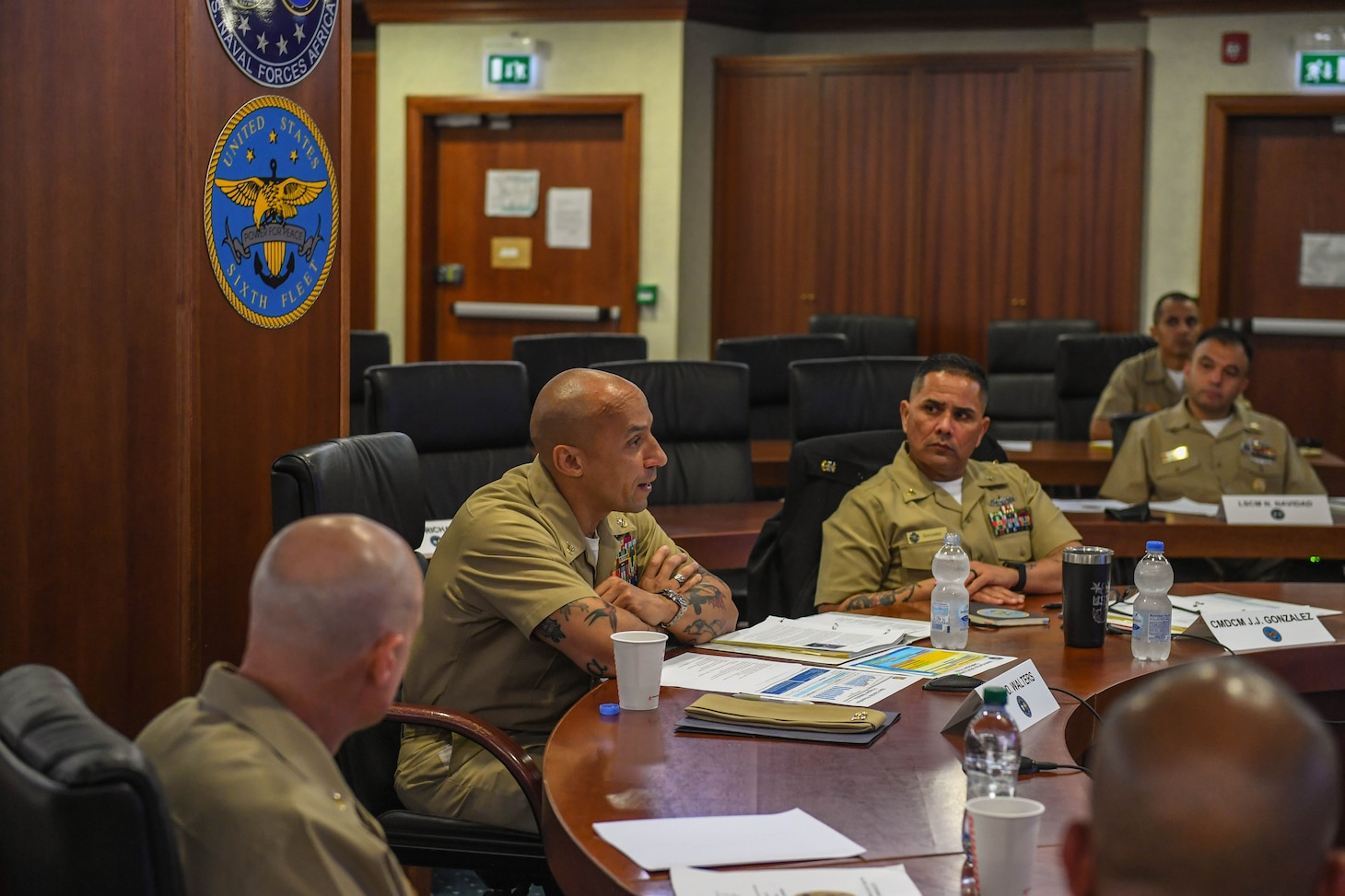 (June 15, 2021) U.S. Naval Forces Europe-Africa Fleet Master Chief Derrick Walters, center, and Command Master Chief Johannes Gonzalez, U.S. Sixth Fleet Command Master Chief, center right, address attendees at a Command Senior Enlisted Symposium at Naval Support Activity Naples, Italy, June 15, 2021. U.S. Naval Forces Europe-Africa, headquartered in Naples, Italy, Conducts the full spectrum of joint and naval operations, often in concert with allied and interagency partners in order to advance U.S. national interests and security and stability in Europe and Africa. (U.S. Navy Photo by Mass Communication Specialist 2nd Class Trey Fowler/Released)