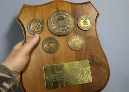 Among the artifacts from three decades of operation of now-closed Camp As Sayliyah-Main, Qatar, is this commemorative plaque which reads: Presented by General Henry H. Shelton, Chairman of the Joint Chiefs of Staff on the occasion of his visit with the Service Members of ARCENT OA, February 1999. ARCENT is the shorthand for U.S. Army Central command, which is responsible for this operations area.