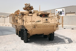 A Stryker armored combat vehicle circles around the Stryker battle damage repair facility at Camp As Sayliyah, Qatar, Oct. 5. The Stryker infantry carrier vehicle had been restored after deterioration during enemy engagement in Iraq.