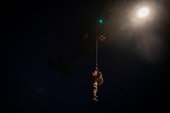 Army Reserve medevac company teaches military working dog handlers hoist procedures