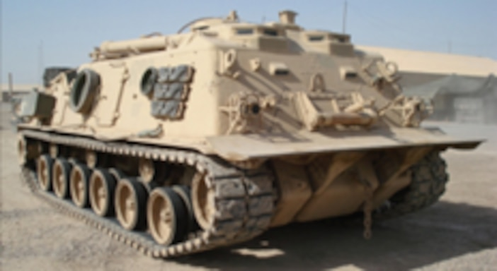 The M88 heavy tank from a side-front angle, sitting stationary in a desert setting.
