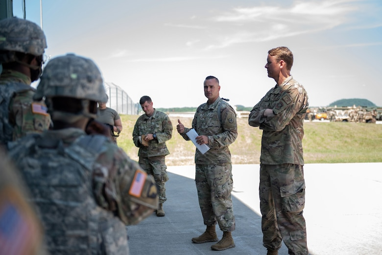 U.S. Army Maj. Christopher Fields (center), commander of the 690th Rapid Port Opening Element, briefs incoming soldiers who will support a Joint Task Force-Port Opening exercise known as Operation Lone Oak at Volk Field, Wis., June 7, 2021. The soldiers are from Fort Eustis, Va., which is home to the Army's three RPOE units. (U.S. Air National Guard photo by Senior Master Sgt. Vicky Spesard)