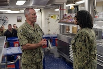 NAVAL STATION NORFOLK (June 23, 2021) Vice Adm. Roy Kitchener, Commander, Naval Surface Force, U.S. Pacific Fleet, speaks with Hospitalman Shakeelah Jordan aboard the Arleigh Burke-class guided missile-destroyer USS Winston S. Churchill (DDG 81) during a ship visit. Kitchener visited Hampton Roads commands and ships June 22-23, and hosted a commander's call with waterfront leadership. (U.S. Navy photo by Mass Communication Specialist 2nd Class Jacob Milham/Released)