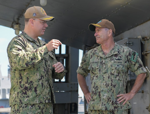 NAVAL STATION NORFOLK (June 23, 2021) Cmdr. Timothy Shanley, commanding officer of the Arleigh Burke-class guided missile-destroyer USS Winston S. Churchill (DDG 81), speaks with Vice Adm. Roy Kitchener, Commander, Naval Surface Force, U.S. Pacific Fleet, during a ship visit. Kitchener visited Hampton Roads commands and ships June 22-23, and hosted a commander's call with waterfront leadership. (U.S. Navy photo by Mass Communication Specialist 2nd Class Jacob Milham/Released)