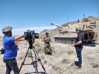 Reporters from KUTV 2 news interview Staff Sgt. Michael Jordan, section chief C Battery, 145th Field Artillery Battalion at Dugway Proving Grounds, Utah, June 12, 2021. The battalion was demonstrating fires capabilities during annual training for the media to observe