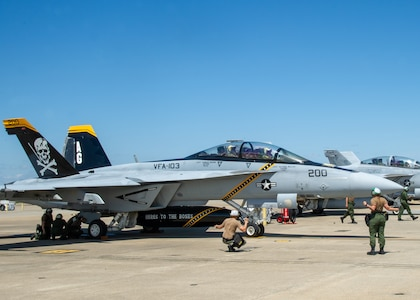"""An F/A-18F Super Hornet, assigned to the """"Jolly Rogers"""" of Strike Fighter Squadron (VFA) 103, prepares to taxi"""