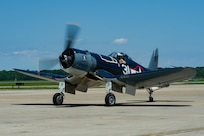 An FG-1D Corsair, flown by Mike Spalding, Chief Pilot Military Aviation Museum, taxis after a heritage flight with Strike Fighter Squadron (VFA) 103