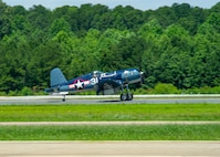 An FG-1D Corsair, flown by Mike Spalding, Chief Pilot Military Aviation Museum, lands on the runway after participating in a heritage flight with Strike Fighter Squadron (VFA) 103