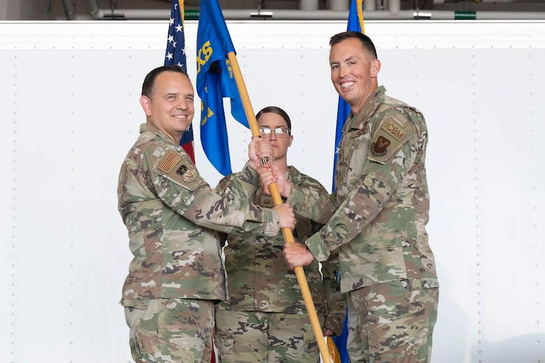 Maj. Michael B. Hampton, right, accepts command of the 741st Maintenance Squadron from Col. Nathan Mitchell, left, 341st Maintenance Group commander, during a change of command ceremony June 24, 2021, at Malmstrom Air Force Base, Mont.