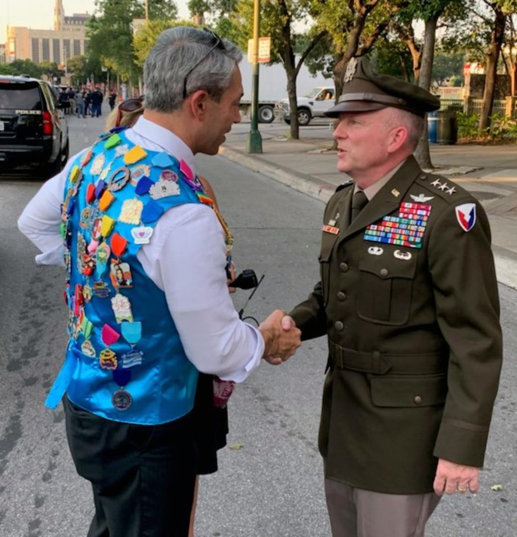 Lt. Gen. Douglas Gabram (right), Installation Management Command commanding general, shakes hands with San Antonio Mayor Ron Nirenberg during the Fiesta event June 17.
