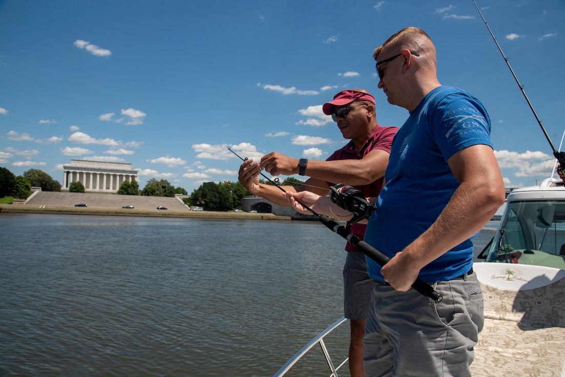 Recovering service members learn to fish.
