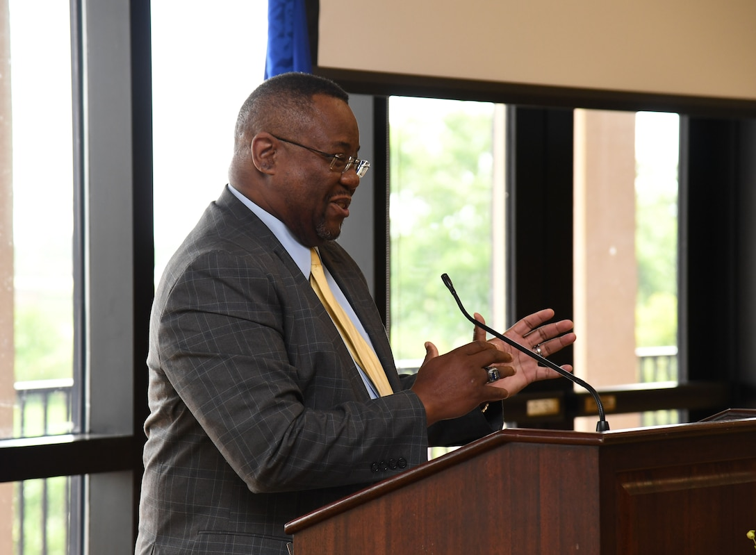 Kurt Higgins, 81st Training Support Squadron faculty development chief, delivers remarks to attendees during a Juneteenth ceremony inside the Bay Breeze Event Center at Keesler Air Force Base, Mississippi, June 23, 2021. June 19, other wise known as Juneteenth, is an annual observance of the emancipation of slaves in the state of Texas. (U.S. Air Force photo by Kemberly Groue)