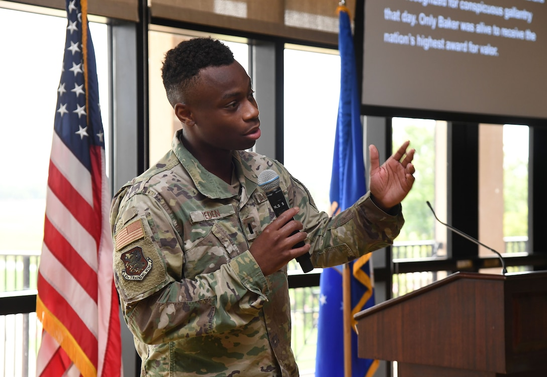 U.S. Air Force 1st Lt. Gerald Peden, Public Affairs Officer, delivers remarks to attendees during a Juneteenth ceremony inside the Bay Breeze Event Center at Keesler Air Force Base, Mississippi, June 23, 2021. June 19, other wise known as Juneteenth, is an annual observance of the emancipation of slaves in the state of Texas. (U.S. Air Force photo by Kemberly Groue)