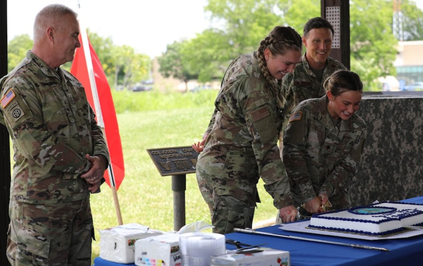 Per military tradition the two senior members of the Air Guard and Army Guard helped cut the cake with the two lowest ranking members in attendance of each branch