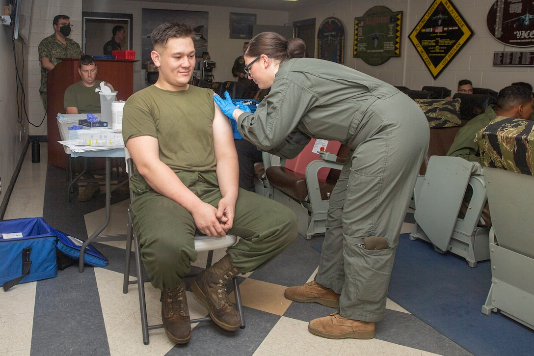 U.S. Marines with Marine Attack Squadron (VMA) 542 receive the Moderna COVID-19 Vaccine at Marine Corps Air Station Cherry Point, North Carolina, June 11, 2021. The vaccine mitigates risks to military operations allowing Marines to maintain their lethality and readiness and be able to respond to any crisis or contingency. (U.S. Marine Corps photo by Cpl. Yuritzy Gomez)