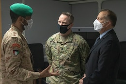 Kuwait Lt. Col. Abdullaziz Al-Rabah, Military Cooperation deputy with the Kuwait Ministry of Defense, speaks with U.S. Army Lt. Col. Edward Lescher, Area Support Group – Kuwait Director of Host Nation Affairs, and Eric Gordon, ASG – KU deputy to the commander, during a bilateral engagement held June 20, 2021, at the Area Support Group – Kuwait Headquarters on Camp Arifjan, Kuwait.  The engagement allowed leaders from both militaries to discuss the continued partnership between the U.S. and Kuwait through the Defense Cooperation Agreement. (U.S. Army photo by Joseph Black)