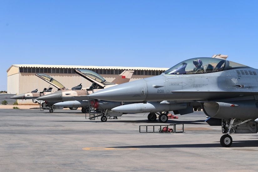 A U.S. Air Force F-16 Fighting Falcon assigned to the 510th Fighter Squadron sits on the flightline near Moroccan F-16s during an Agile Combat Employment event during exercise African Lion 21 on Guelmim Air Base, Morocco, June 16,  2021. ACE events prepare U.S. forces in Africa to protect and defend partners and generate lethal combat air power should deterrence fail. (U.S. Air Force photo by Airman 1st Class Thomas S. Keisler IV)