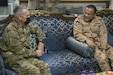 U.S. Army Col. John J. Herrman, Area Support Group – Kuwait commander, speaks to Kuwait Air Force Brig. Gen. Fahad Al-Dosari during a bilateral engagement held June 20, 2021, at the Area Support Group – Kuwait Headquarters on Camp Arifjan, Kuwait.  The engagement allowed leaders from both militaries to discuss the continued partnership between the U.S. and Kuwait through the Defense Cooperation Agreement. (U.S. Army photo by Joseph Black)
