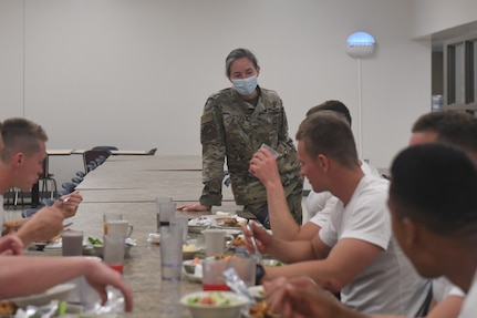 Training students consult with military nutritionist about meal choices.