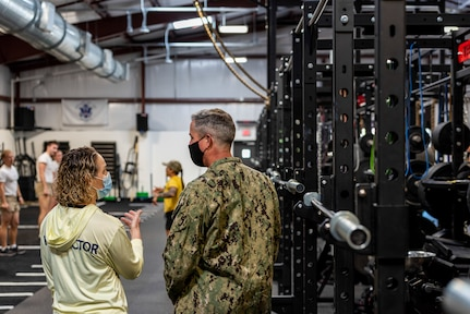 Female instructor briefs a male DV on the new fitness facility.