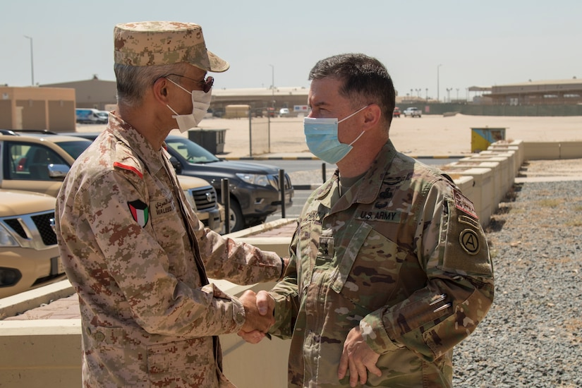 U.S. Army Maj. Gen. Douglas Crissman, U.S. Army Central deputy commanding general (right), welcomes Kuwait Maj. Gen. Waleed Al-Sardi, Kuwait Ministry of Defense Assistant Chief of Staff for Plans and Operations, to a bilateral engagement held June 20, 2021, at the Area Support Group – Kuwait Headquarters on Camp Arifjan, Kuwait. The event allowed key leaders to discuss current and future partnerships between the U.S. and Kuwait. (U.S. Army photo by Joseph Black)