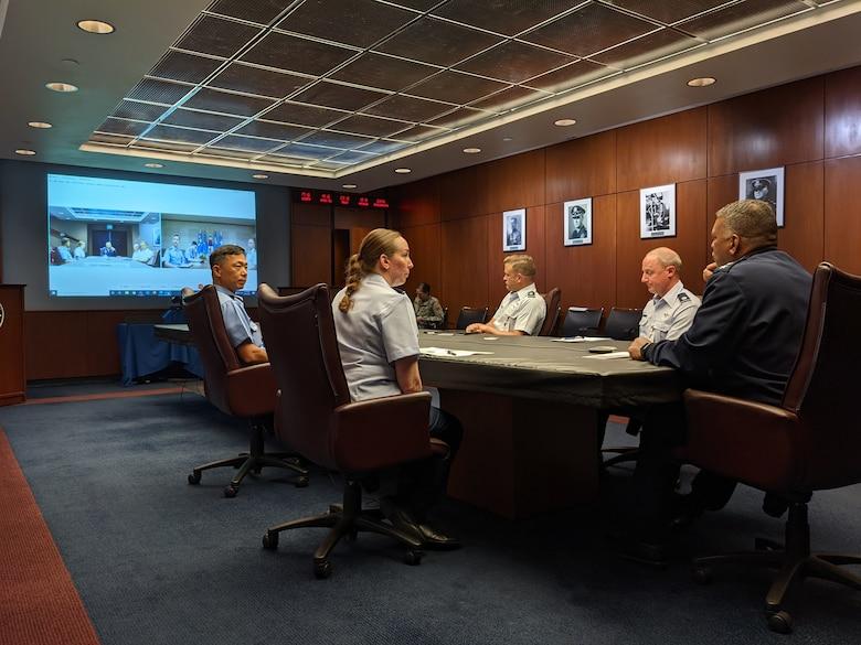 U.S. Air Force Academy Superintendent Lt. Gen. Richard Clark (right) chats via livestream with Lt. Gen. Sung Chun Choi, superintendent of the Republic of Korea air force academy.