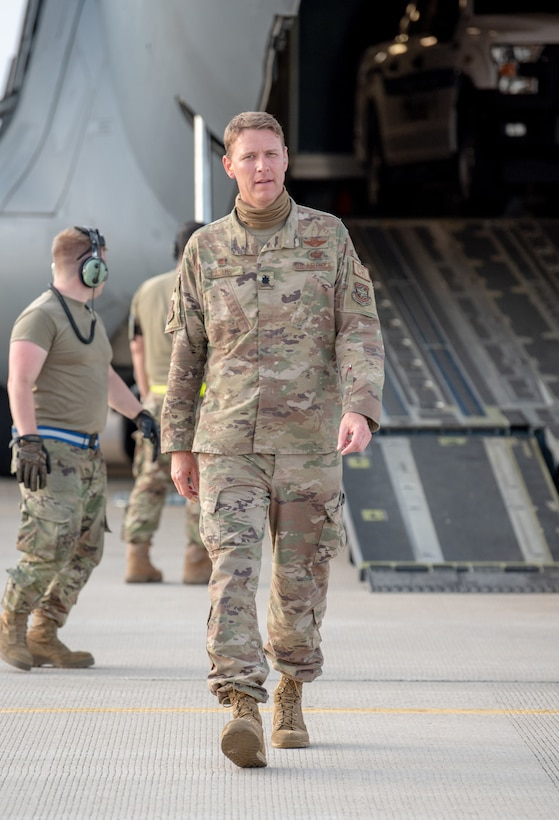 Lt. Col. Ryan Adams of the Kentucky Air National Guard's 123rd Contingency Response Group observes cargo off-loading procedures by CRG aerial porters at Volk Field, Wis., June 11, 2021, during a Joint Task Force-Port Opening exercise known as Operation Lone Oak. Adams served as JTF-PO commander for the exercise, which tasked participants with establishing a complete air logistics hub and surface distribution network from scratch. (U.S. Air National Guard photo by Senior Master Sgt. Vicky Spesard)